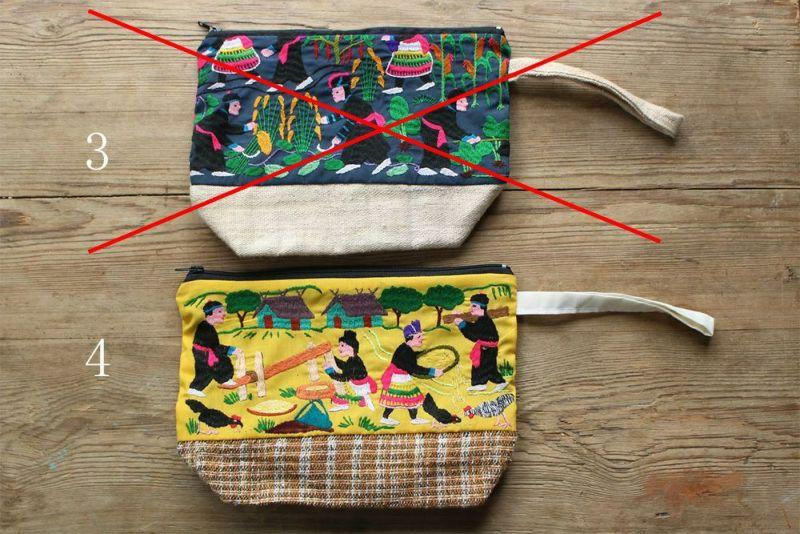 モン族の村の様子がデザインされた刺繍
